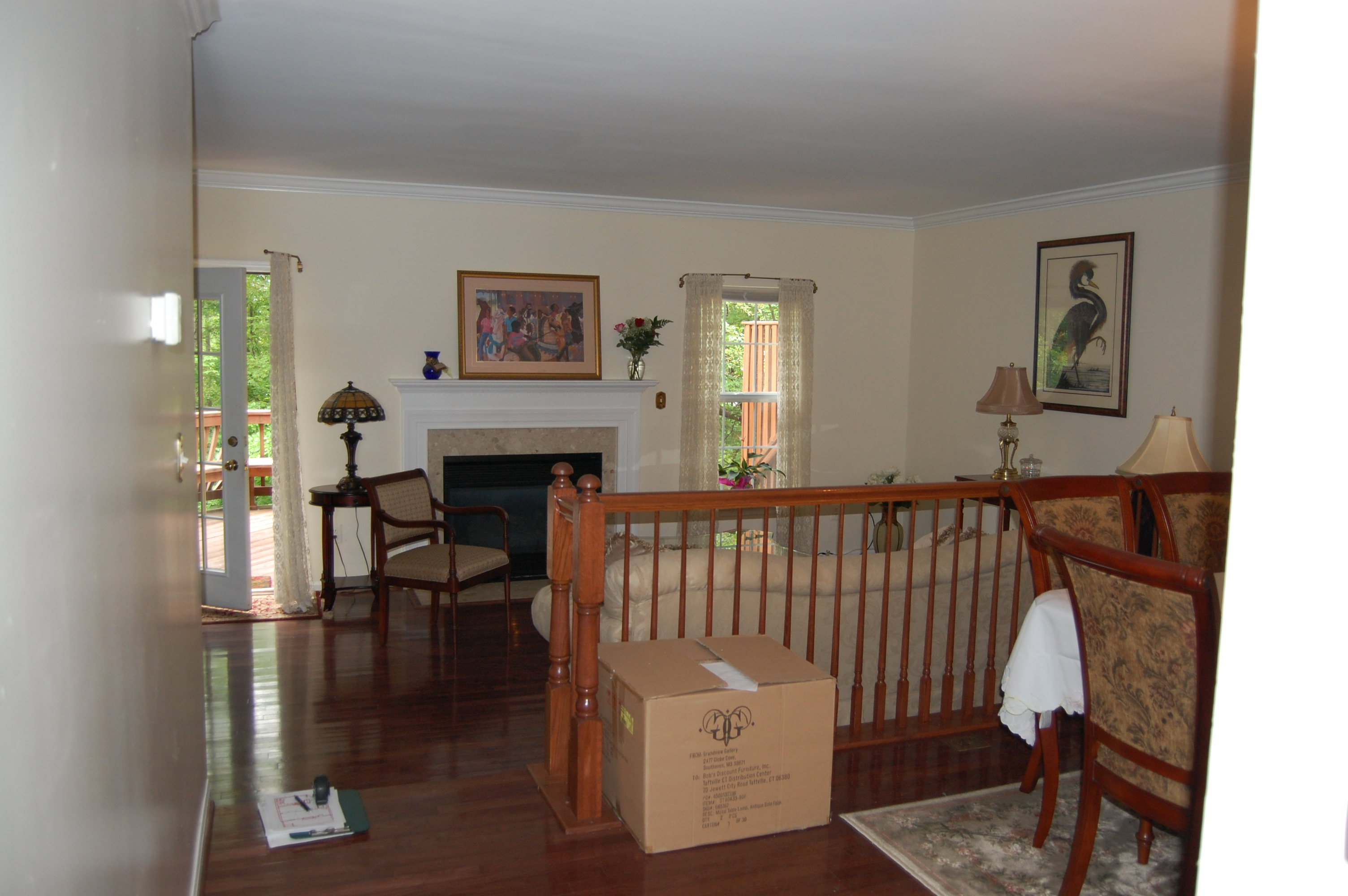 This Photo Is Standing In The Dining Room Looking Into The Living Room. The  Two Spaces Are Divided By A Banister And About An 8u201d Finish Floor  Difference.