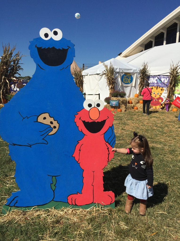 I love that she is holding Elmo's hand... Our weekend adventures to the NC State Fair!